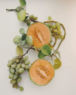 mango and grapes on a vine